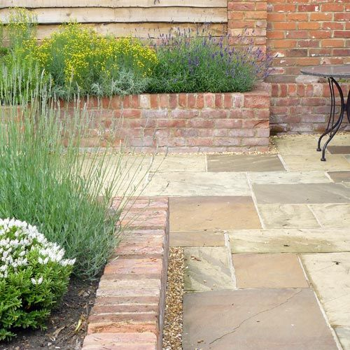 High Stone Wall Garden With Rectangular French Marble: Raised Brick/stone Planters Would Be Great As Borders For