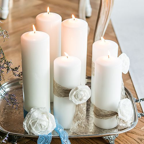 These classic Round Pillar Candles will create the romantic atmosphere that you have been looking for. These neutral candles will fit into any color scheme and work great in centerpieces. Sold individually. Available for purchase online at http://madelinesweddings.weddingstar.com/product/round-pillar-candles