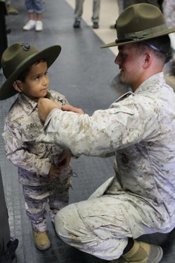 Sgt. Daniel Mullis pins an expert badge on Jorge Solis, 5, who visited the base as a wish child with the Make-A- Wish Foundation of Orange County who suffers from retinoblastoma, a rare type of eye cancer.Badges, Orange County, Training Cours, Children, Military Moments, Day Camps, Little Boys, Camps Pendleton, Marines Corps
