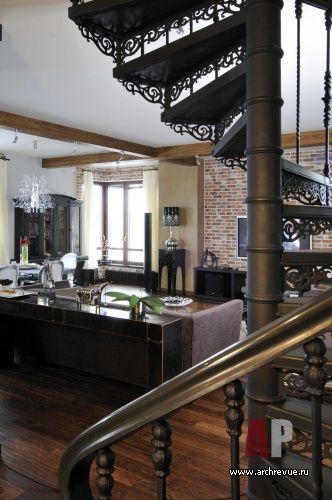 Дизайн интерьера двухэтажной квартиры в новостройке   Одним из значимых элементов интерьера общей зоны становится кованая лестница, выполненная по эскизам автора. Чертежи и разработка компания «Раскада»