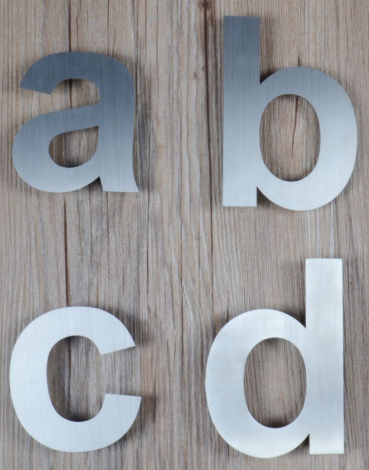our stainless steel house letters on a beautiful wood background