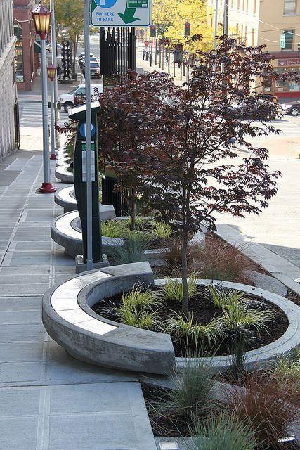Stormwater planters on Maynard green street, Seattle by SvR Design Co. For more smart urbanism visit the Slow Ottawa 'Streets for Everyone' Pinterest board, and please repin to help make a difference.