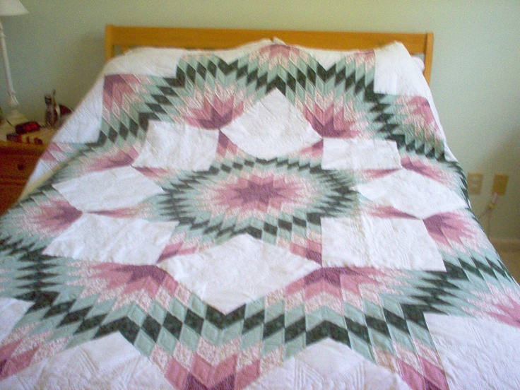 This quilt was made for our dear friends George & Cathy when they moved from Maryland to North Carolina. It is a queen sized Broken Star completely made by hand. Cut over 1,000 pieces by hand, stitched the pieces by hand and quilted it by hand. I really didn't want to give it up!