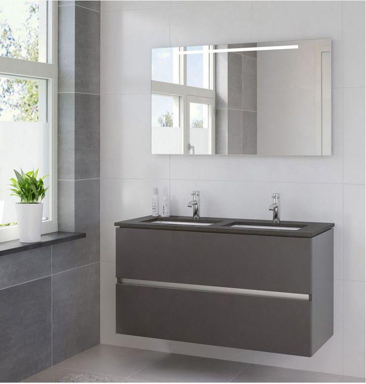 Miko is een nieuw badkamermeubel in het Bruynzeel assortiment. Dit badkamermeubel is voorzien van een zeer lage keramische wastafel en 2 gelijke, greeploze laden met een tijdloze uitstraling. Er is keuze uit een wit keramische wastafel, of een zwart granieten blad met daaronder een rechthoekige wit keramische onderbouw waskom. Een spiegel met horizontale TL-verlichting of spiegelkast maken uw badmeubelset compleet.