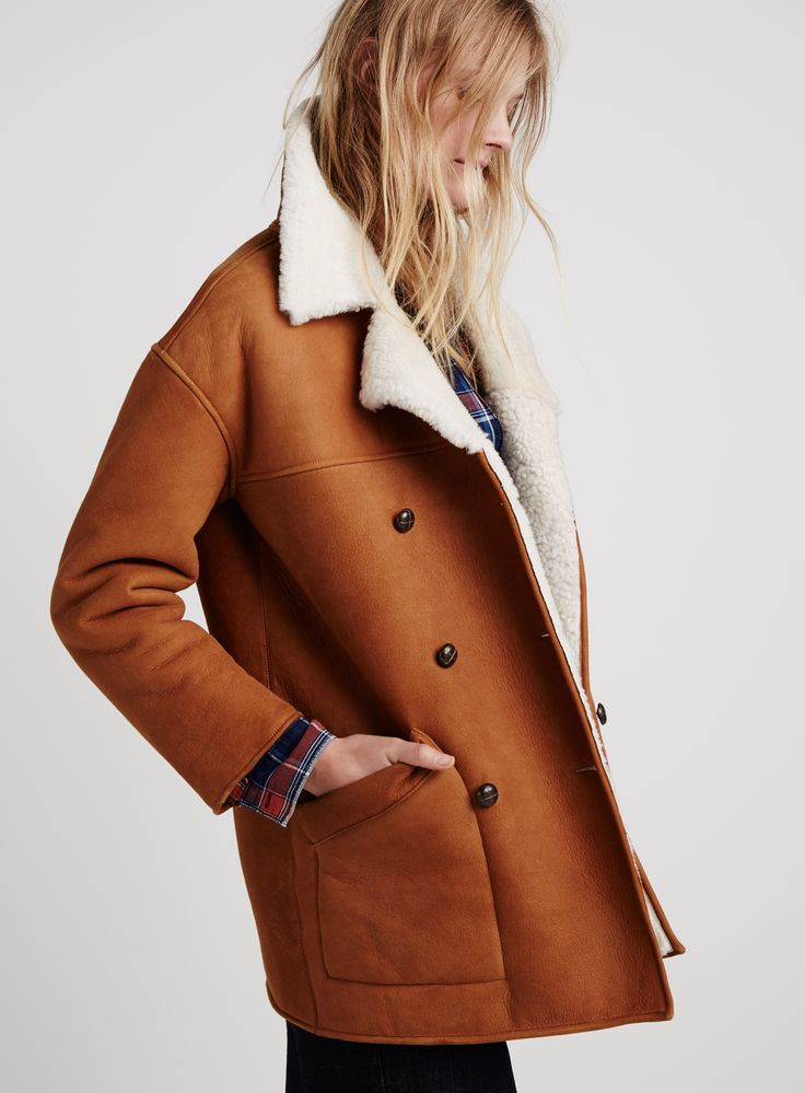 madewell shearling car coat worn with the wrap overlay shirt.