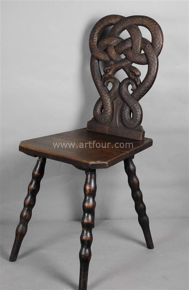 A Rare Carved Black Forest Snake Chair Ca. 1900