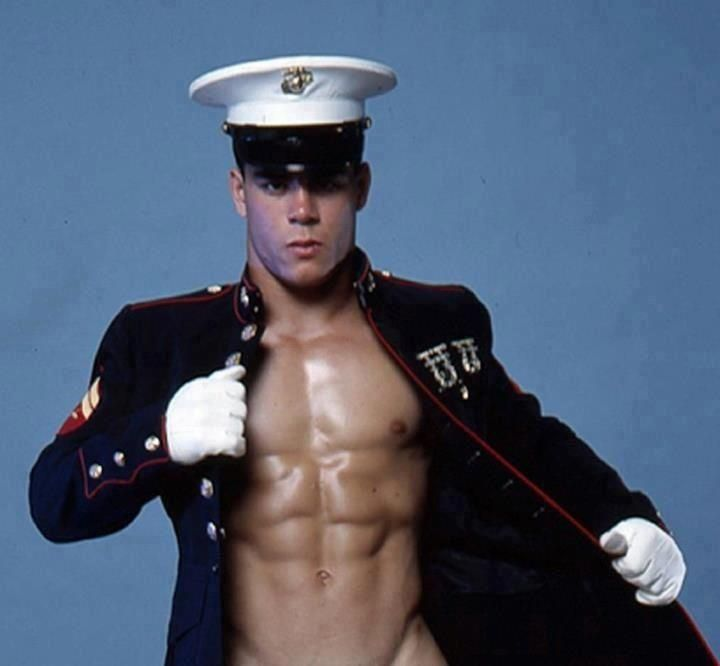 Sexy shirtless marine wearing blue uniform coat and white ...