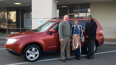 Folger Subaru Sales Consultants Jim Gamble & Gary Guine with Ms. Stoudenmire and her 2010 Subaru Forester SUV!