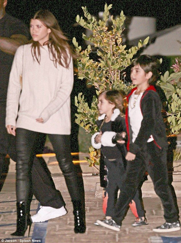 Out and about: Sofia Richie and Scott Disick he Instagram model, 19, and her reality star beau, 34, were spotted out together again in Malibu on Saturday night; Sofia pictured with his kids Penelope and Mason