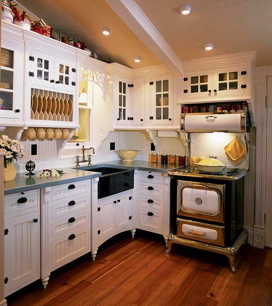 Awesome Beadboard Cabinets Resting On Turned Feet And A Nickel Plated Heartland  Stove Bring Victorian Charm