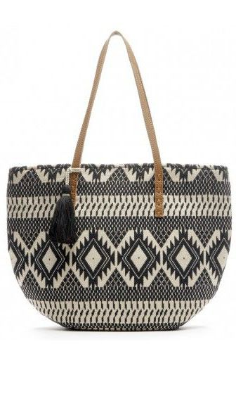Black & white tribal-printed bucket tote with genuine leather shoulder straps and tassel detailing