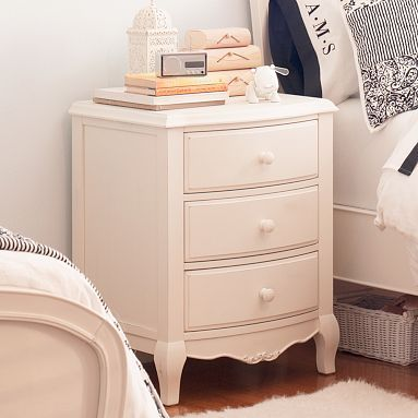 A classic bedside table with a feminine touch.