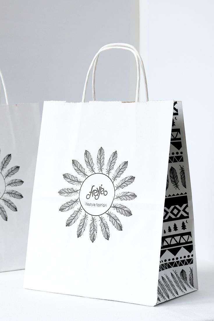 Retail bag design for Freyja. Freyja is a little fashion boutique in the mountain town of Fernie, British Columbia. I worked as a retail assistant at Freyja and worked with the owner of the store to rebrand the store, set up brand / style guidelines and design the new roll out across the following applications: logo, retail bags, in-store signage, business cards, swing tags, social media content etc. The black and white bag design was to go with the new feather style logo.
