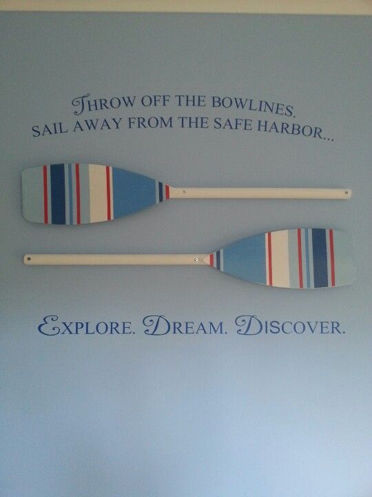 Nautical boys bedroom - decorative oars and Mark Twain quote.