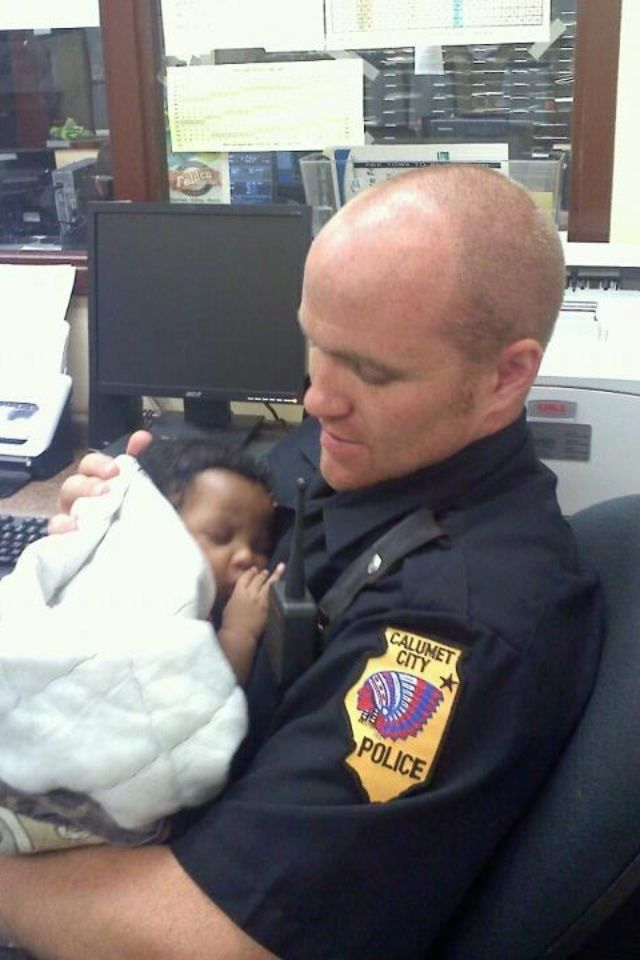A cop holding a baby that was found in an abandoned house. This is the side of the police that i wish would be put out there more often!