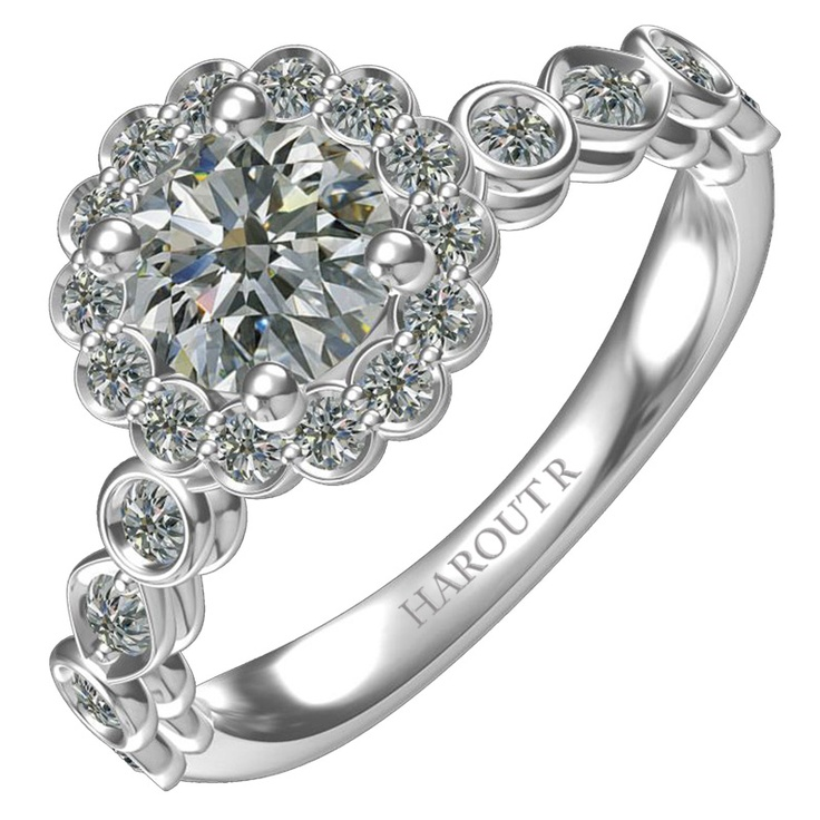 Harout R Modern Diamond Engagement Ring with Halo Design  Stock number: 1R557G  0.56ctw 4 prong round center stone encircled by a single row floral scallop head with designer pave shank.