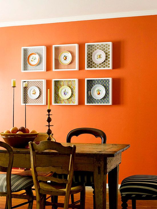 Orange dinning room-Love the shadowboxes for decorative plates accentuated with geometric prints! Clever style