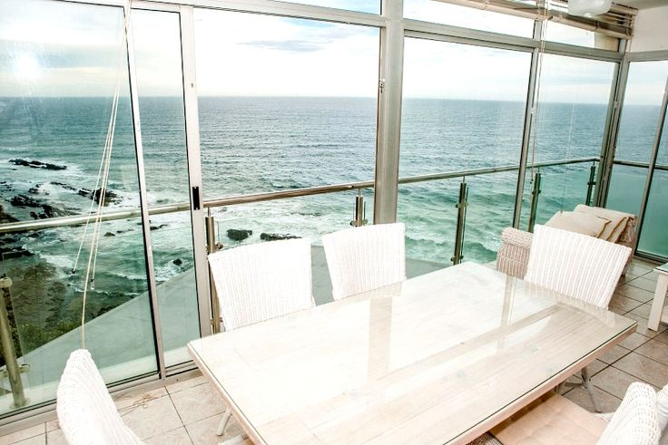 **NEW LISTING** Unit 401 Villa Royale ~ Sheffield Beach, North Coast, KZN  Luxurious self catering beach apartment situated on the 4th floor with 180 degrees ocean views. 3 sizeable bedrooms, with bespoke contemporary finishes and ultra luxurious main en-suite. Modern open plan lounge, dining and kitchen, all with a captivating view of the horizon with comfortable balcony perfect for spotting marine life.