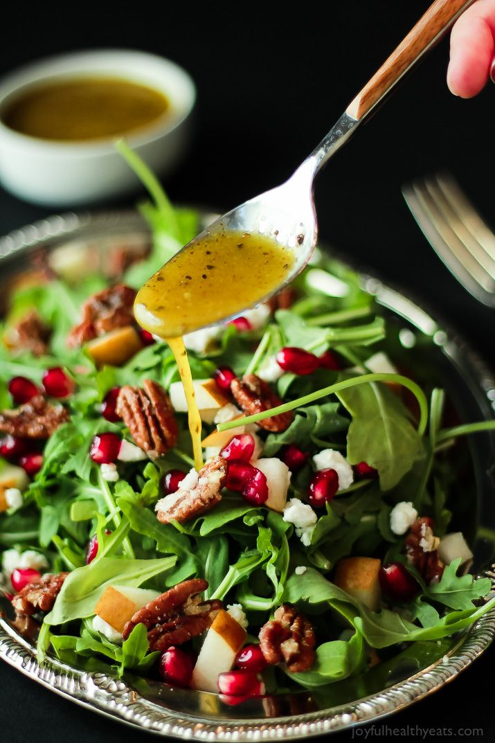 Pomegranate Goat Cheese Candied Pecan Arugula Salad. The perfect salad to change up your holiday menu, easy to make and absolutely delicious!   www.joyfulhealthyeats.com