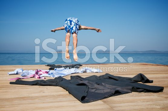 Businessman Takes off Suit and Dives into Sea royalty-free stock photo