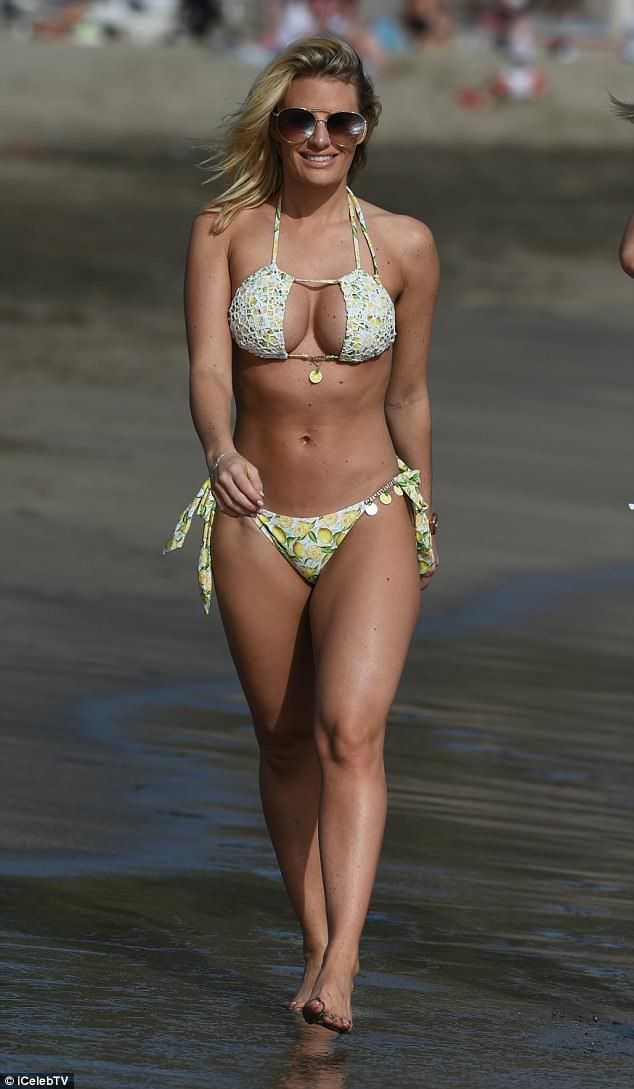 8103d2488 Beach babe: Danielle Armstrong paraded her gym-honed figure as she hit the  beach with Ferne McCann and her daughter Sunday in Spain on Friday