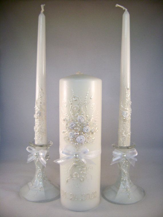 GORGEOUS Wedding unity candle set - 3 candles and 2 candleholders in pearl ivory and white. $69.00, via Etsy.