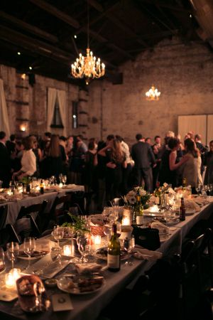The atmosphere and feel of a space can so transform a wedding. It can take it from industrial venue to cozy, candlelit reception with a cool speakeasy vibe. The Green Building is doing just that with a bit of crafting by Erin Braun,