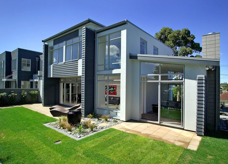 Give your house a modern look with a striking contrast of black painted weatherboards and white bagged brick (ID 683)