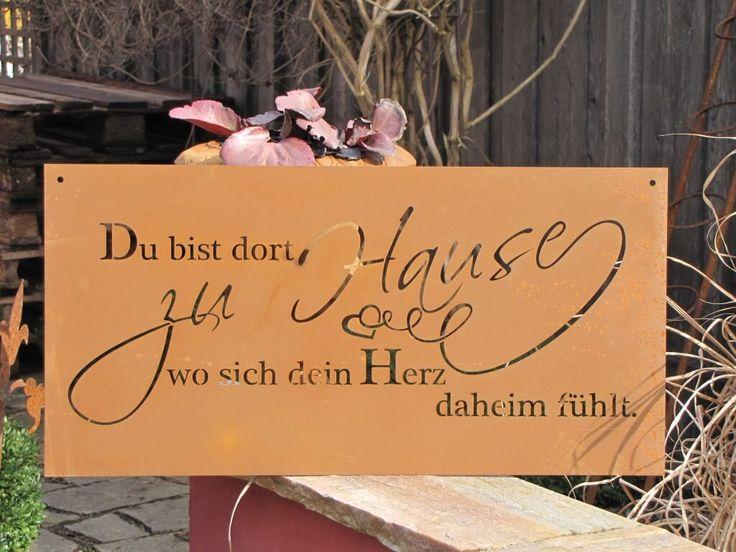 """Edelrost Gedichttafel Heimat Die Spruchtafel ist ein Hingucker in jedem Garten und zieht gerade in Vorgärten die Blicke auf sich.  Spruch auf der Tafel lautet:  """"Du bist dort zu Hause wo sich dein Herz daheim fühlt.""""  Größe:      Höhe: 30 cm     Breite: 60 cm  Preis: 30,- €"""