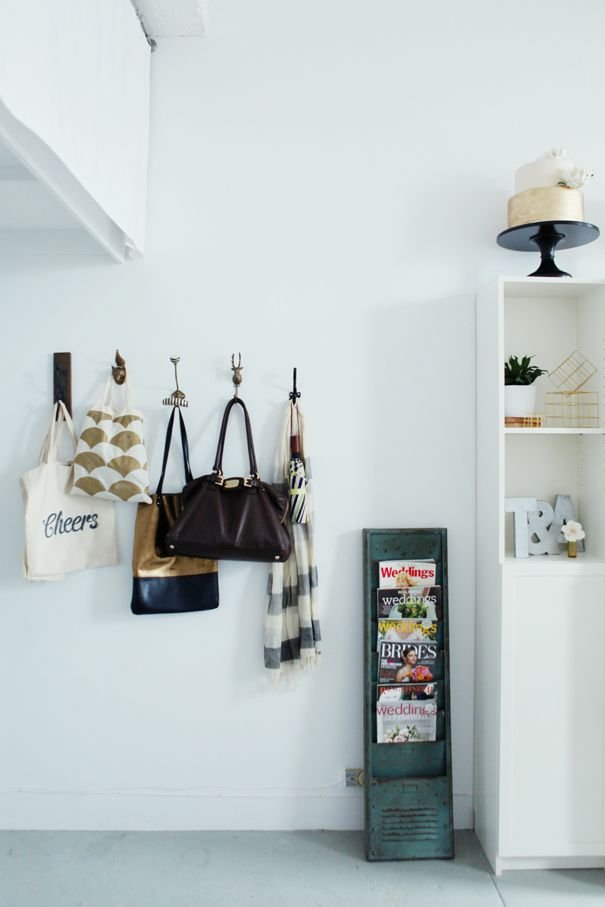 I like the idea of using different hooks in the entry way. It's funky and fun and works really well! #decor