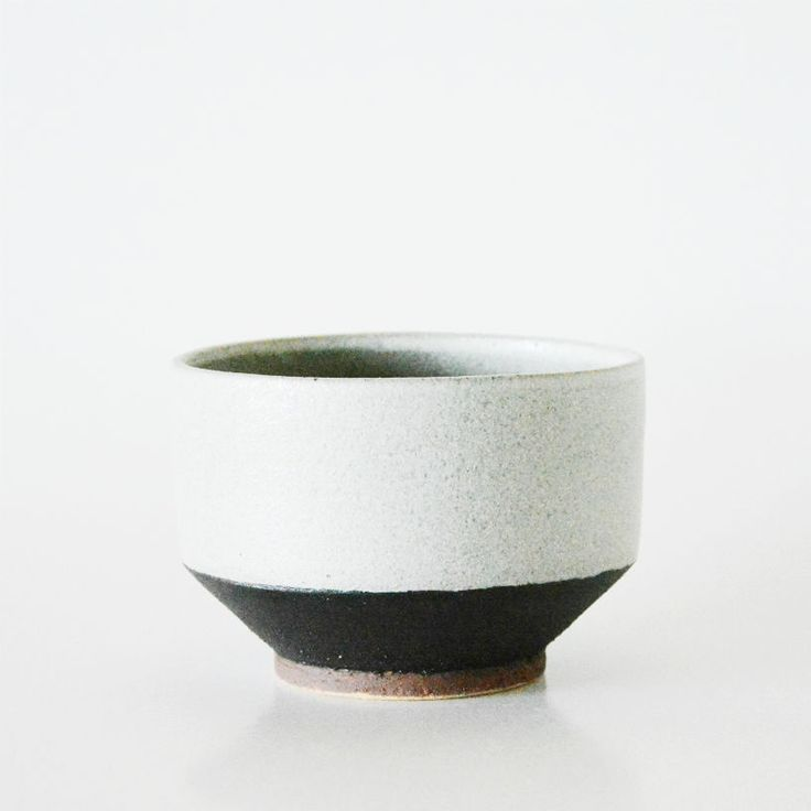 Handthrown stoneware bowl w. black slip and white glaze. The red foot is the raw, unglazed clay. H: 9 cm.Dia: 12,50 cm.One-offs only!