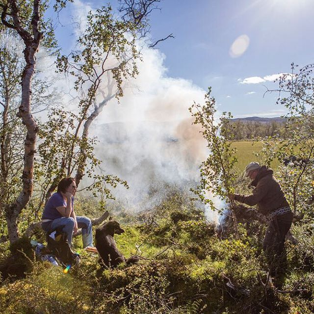 Kilpisjärvi, Finnish Lapland. Mia and Nils start a fire to keep the mosquitoes at bay. We had a picnic of smoked salmon, orange Sunkist, dark chocolate, strong coffee and a handful of cloudberries. Photo by Kirsten Luce.
