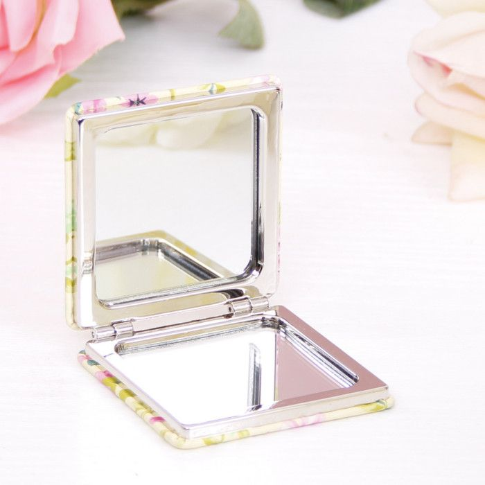 This modern compact mirror is the perfect little stocking filler for the lady in your life. Featuring a beautiful floral design mix of yellows and pinks, it's the ideal way for her to see how wonderful she is.