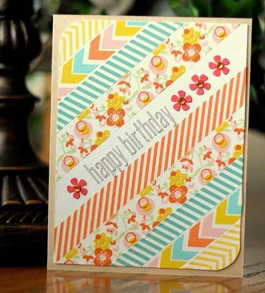 handmade birthday card by Michelle Unruh ... panel of lovely washi tapes on the diagonal ... sentiment and punched flowers run up the empty line ... great way to use washi ,,