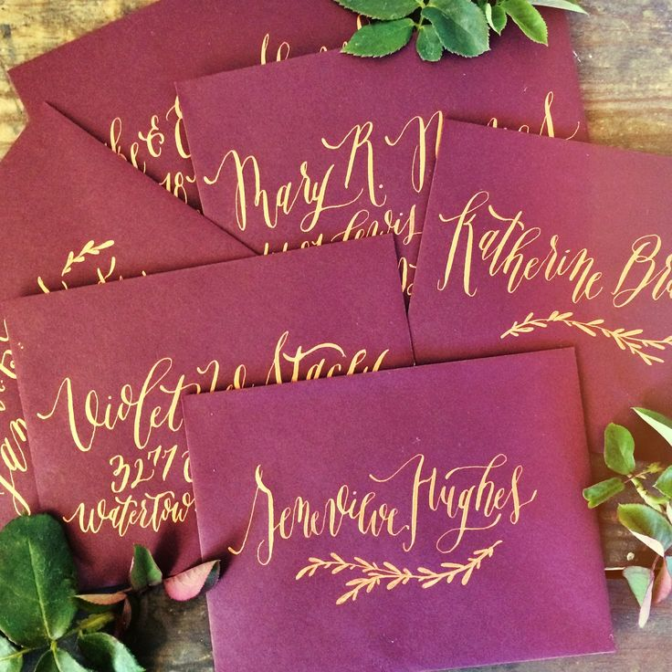 Envelope Calligraphy by Annie Mertlich | Wildfield Paper Co. - rich gold on wine colored envelopes; love the leaf ornament