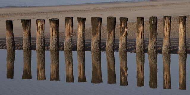 Wave breakers on the beach at Schoorl - Holland by dirk huijssoon, via Flickr