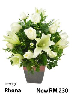 12 white roses & 5 white lilies in a glass vase.