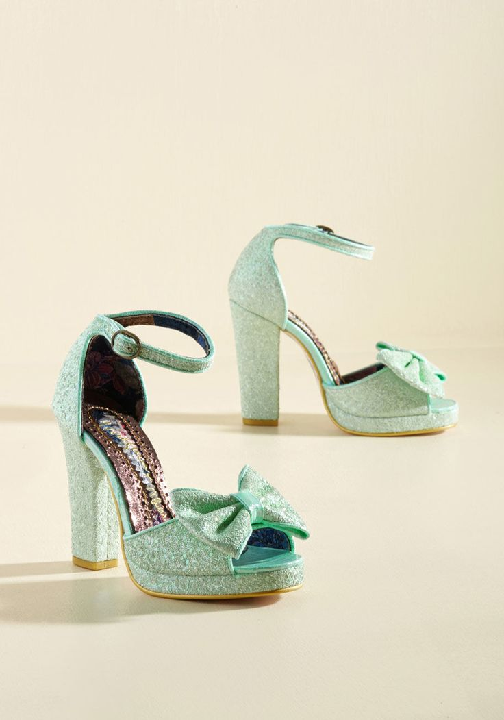 <p>Between their recognizable cadence and their breathtaking, glitter-encrusted uppers, these mint green pumps sure do leave a memorable impression! Platforms and precious bows further finesse these showstopping heels from Irregular Choice, and round out an ultra-stylish sensory experience.</p>