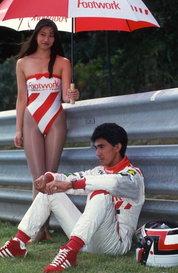 F1 driver Aguri Suzuki and one of the Footwork grid girls 1992.