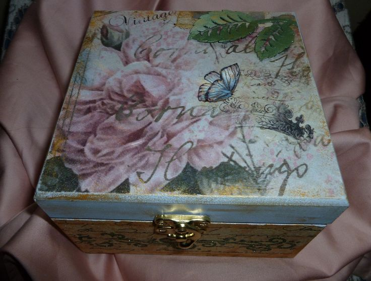 'Butterflies & Roses ' MDF Box- Imagination Craft's=MDF Box.  Art Cutz leaves.  Rice papers 343 & 174.  Inca gold and Peridot Alchemy waxes.  Golden green Sparkle Medium.  Metal spatula.  Gold card.  Menthol Starlight paint.  White & Baltic Blue MDF paints.  PVA glue.  Lacy square die-Marinne Design.  Butterfly die - White Rose Studio.   January 2016.
