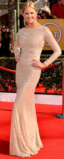 Nancy O'Dell: 2014 SAG Awards  The TV personality sparkled in a long-sleeved, form-fitting, blush-colored sequin gown paired with large earrings and jewels.  Read more: http://www.usmagazine.com/red-carpet/nancy-o-dell-2014-sag-awards-2014181#ixzz2qrS4lKbo