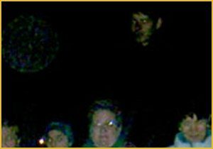 """FLOATING HUMAN FACE! Fabienne from Germany writes, """"I am very interested in ghosts and spiritual things. After I have heard that you can find ghosts in pictures, I've looked at the photos I've taken. This picture was taken last November at the """"St. Martins Umzug"""" from the Kindergarten of my son. Nearly in the middle on top of the picture can you see the dark face. I really don't know what it is, but it would have to be very tall, if this were a human."""""""