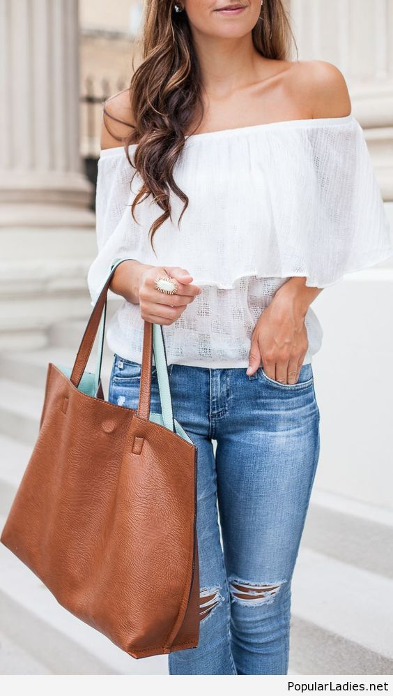 Blue jeans and white top with a brown bag