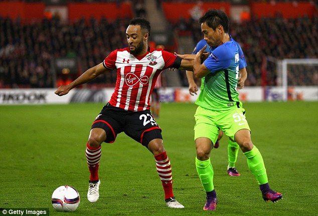 Southampton winger Nathan Redmond shields the ball from Yuto Nagatomo