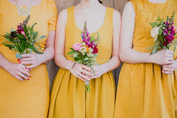yellow bridesmaid dresses with colorful bouquets | Heirloom Collective #wedding