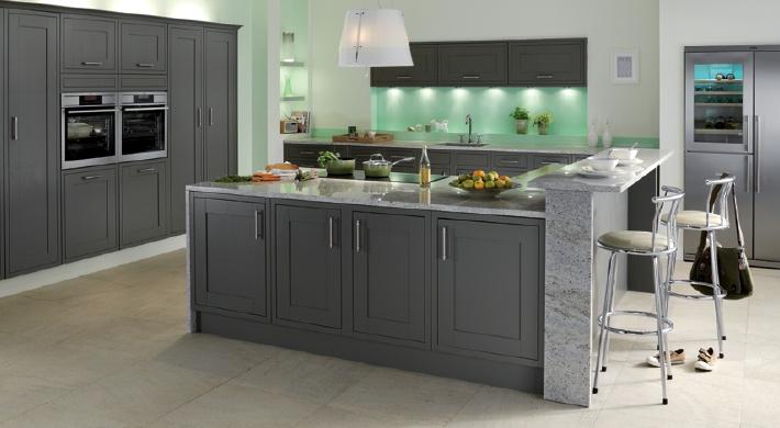 The Somerton Fern Kitchen Range. A stylish kitchen featuring an earthy, coloured painted door. #bespoke #kitchen #shaker #grey