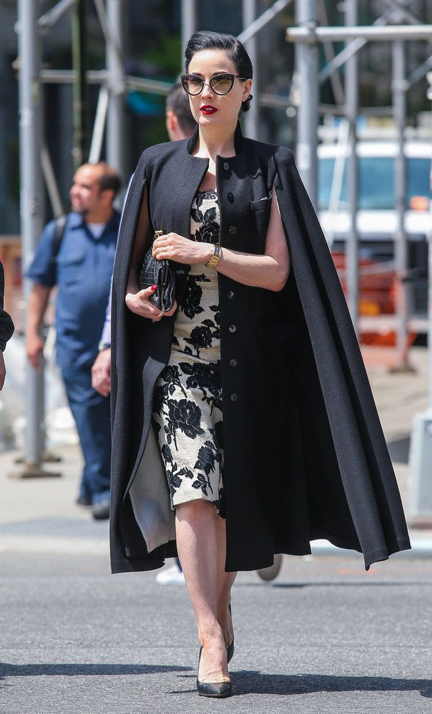 I freakin love a cape . Not to mention that Dita Von Teese is stunning in anything.