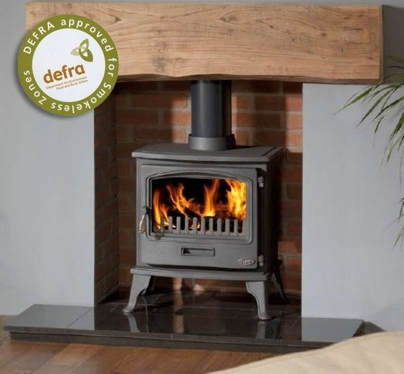 Wood burner in grey room with wooden mantle and brick surround.