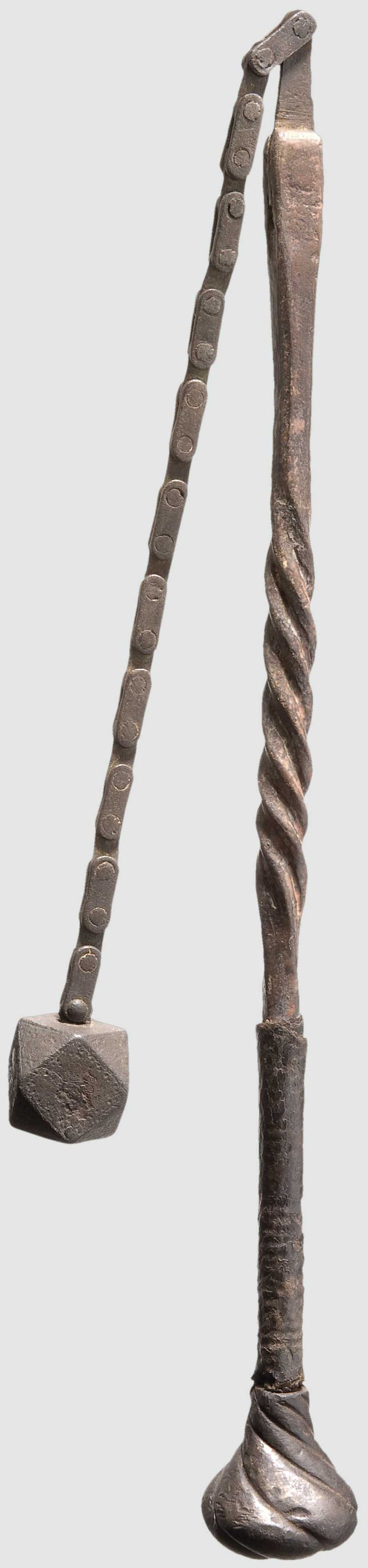 A Southern German battle flail circa 1520/30 Iron, polygonal striking head on a riveted chain. The forged twisted iron shaft retaining the original leather covering with cord underlay and a pommel of a two-handed sword of ca. 1520. Patinated, with vestiges of red lead coating. Shaft length 55 cm. Rare example of a flail weapon from the period of the Peasants' War.