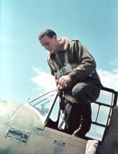 """An young and well dressed Italian military pilot boarding on a fighter aircraft Macchi MC.202 """"Folgore"""". Note an immaculate flying jacket Marus weared over an uniform well pressed and boat polished: a great difference with the pilots at the front."""